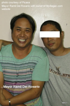 Mayor Del Rosario with a friend. He's not gay.