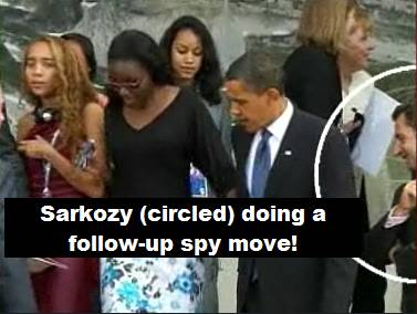 Sarkozy bends his neck! And flashes a naughty grin...
